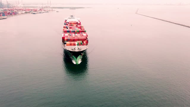 aerial view of container ship in sea - paesi del golfo video stock e b–roll