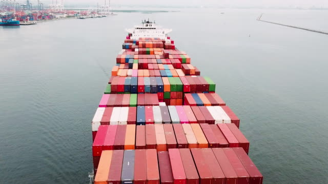 Aerial view of container ship in sea Aerial view of container ship in sea cargo container stock videos & royalty-free footage