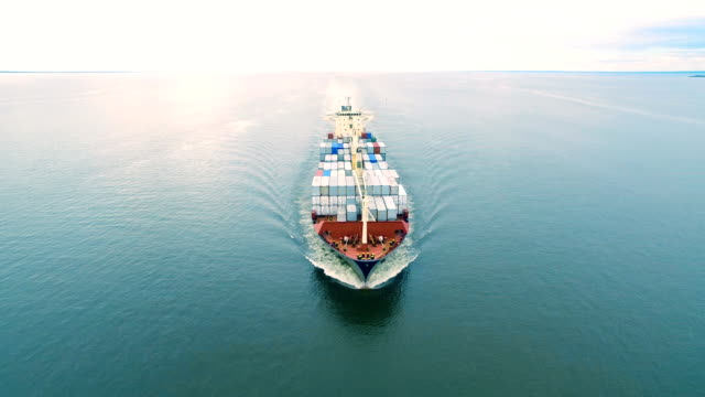 Aerial view of container ship sailing in sea Aerial view of container vessel sailing in open sea large stock videos & royalty-free footage