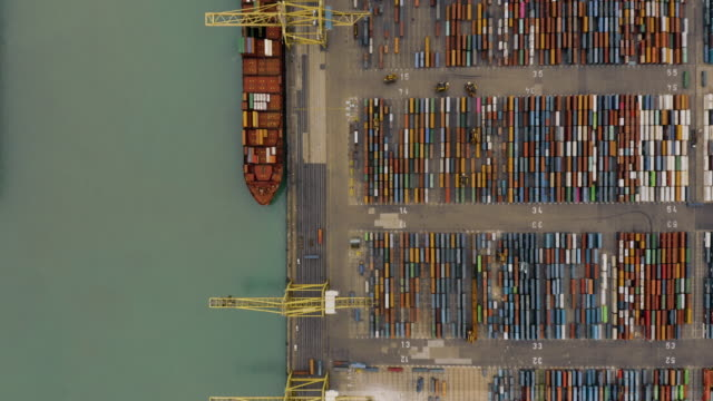 aerial view of container ships and port - warehouse aerial stock videos & royalty-free footage