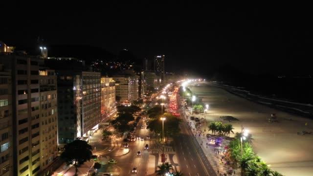 aerial view of copacabana beach at night, rio de janeiro - проспект стоковые видео и кадры b-roll
