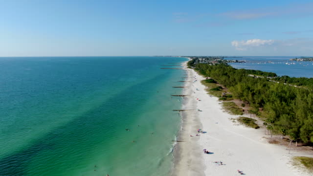 Aerial view of Coquina Beach white sand beach and turquoise water