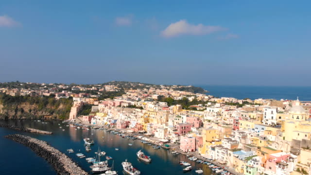 aerial view of corriccella fisherman village in procida island near naples italy - procida video stock e b–roll