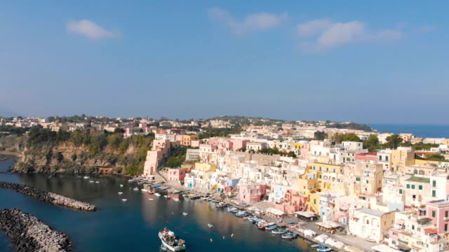 aerial view of corricella fisherman village in procida island near naples italy - procida video stock e b–roll