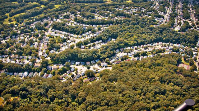 flygvy över landet. träd området. skogen. house. liten stad. - massachusetts bildbanksvideor och videomaterial från bakom kulisserna