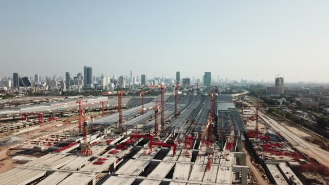 Aerial view of Cranes in site construction Aerial view of Cranes in site construction uk border stock videos & royalty-free footage