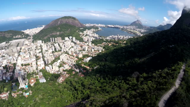 Aerial view of Cristo Redentor, Corcovado and the city of Rio de Janeiro, Brazil Flying over the mountains looking to the Corcovado, behind the scene we can see