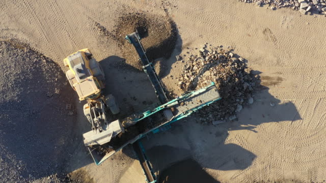 aerial view of crushed stone quarry machine - ghiaia video stock e b–roll
