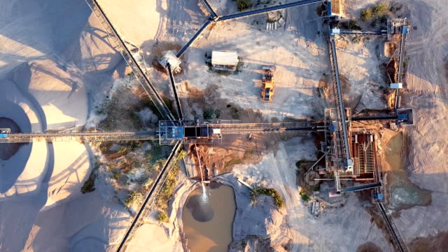 Aerial view of crushed stone quarry machine video