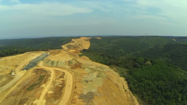 Aerial View of Deforestation for Making a Bridge