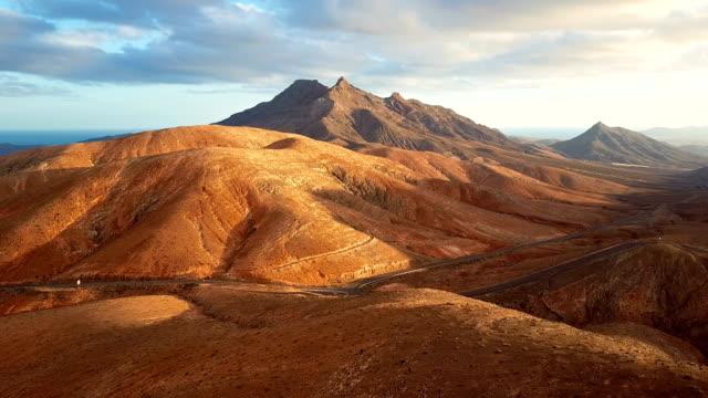 Aerial view of desert landscape at sunset, Fuerteventura island, Spain video