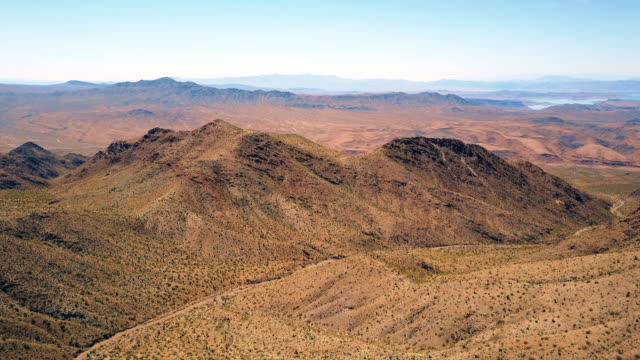 aerial view of desert mountain range and lake 4k - nevada video stock e b–roll