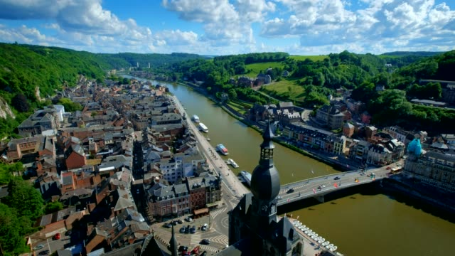 Aerial view of Dinant town, Belgium Aerial view Dinant town, Collegiate Church of Notre Dame de Dinant, River Meuse and Pont Charles de Gaulle bridge from Dinant Citadel. Belgium. Camera pan effect fort stock videos & royalty-free footage