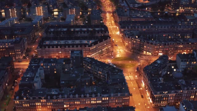 Aerial view of downtown Amsterdam in evening, Netherlands from above, drone footage video