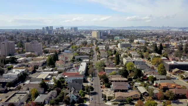 Aerial view of  Downtown  Oakland and San Francisco Aerial view above Piedmont Ave. in Oakland as we move slowly away from the skyscrapers of downtown Oakland. On this clear sunny day you can see the city skyline of San Francisco across the San Francisco Bay. oakland stock videos & royalty-free footage