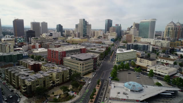Aerial View of Downtown Oakland California Stock 4k resolution UHD video of downtown Oakland California with the 980 freeway in the foreground. oakland stock videos & royalty-free footage