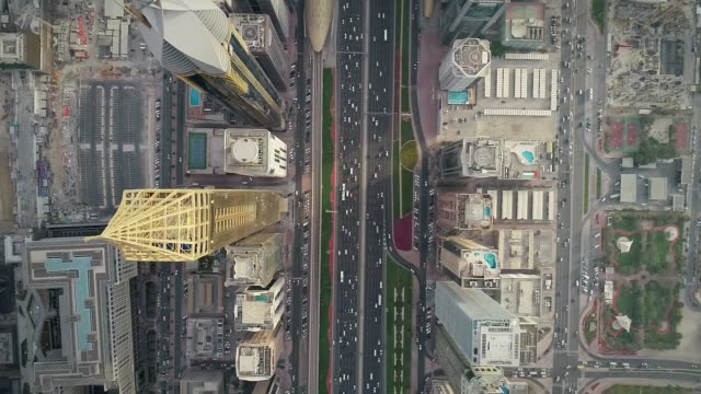 aerial view of dubai colourful skyscrapers, and long busy road ,uae. - dubai architecture stock videos & royalty-free footage
