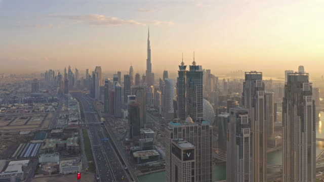 Aerial view of Dubai Downtown skyline, highway roads or street in United Arab Emirates or UAE. Financial district and business area in smart urban city. Skyscraper and high-rise buildings at sunset. Aerial view of Dubai Downtown skyline, highway roads or street in United Arab Emirates or UAE. Financial district and business area in smart urban city. Skyscraper and high-rise buildings at sunset. dubai architecture stock videos & royalty-free footage