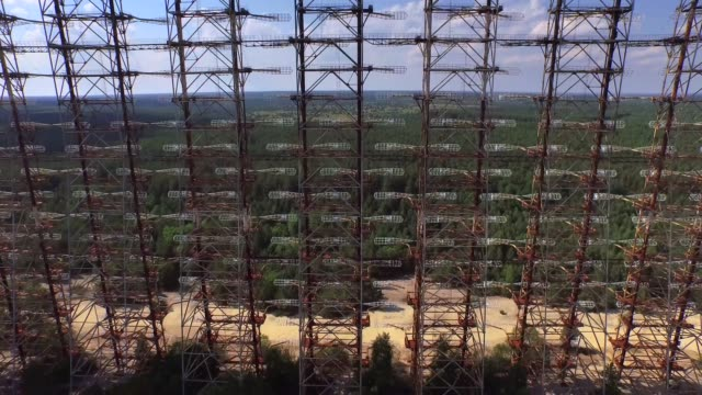 """Aerial view of Duga - Soviet over-the-horizon radar system or The Russian Woodpecker. Ukraine. """"Duga"""", the Steel Giant Near Chernobyl. nuclear missile stock videos & royalty-free footage"""