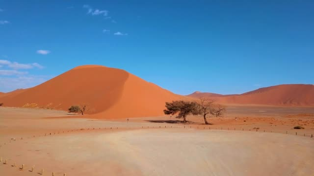 Aerial view of Dune 45, Sossusvlei Namibia Aerial view of Dune 45 in namib desert Sossusvlei, Sesriem Namibia namibia stock videos & royalty-free footage