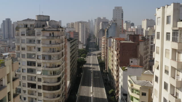 Aerial view of Elevado Costa e Silva, called Minhocao, Sao Paulo, Brazil Large Avenue empty during Covid-19 quarantine, in a sunny day são paulo state stock videos & royalty-free footage