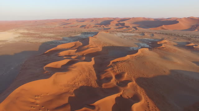 4K aerial view of endless sand dunes of the Namib desert inside the Namib-Naukluft National Park 4K aerial view of endless sand dunes of the Namib desert inside the Namib-Naukluft National Park namibia stock videos & royalty-free footage