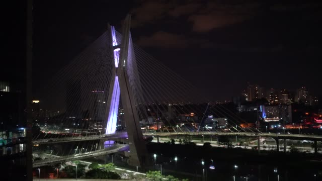 Aerial view of Estaiada bridge and skyscrapers in Marginal Pinheiros at night in Sao Paulo, Brazil Aerial view of Estaiada bridge and skyscrapers in Marginal Pinheiros marginal pinheiros stock videos & royalty-free footage