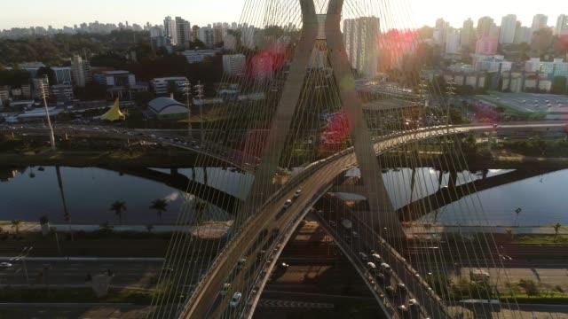Aerial view of Estaiada bridge and skyscrapers in Marginal Pinheiros, Sao Paulo, Brazil Aerial view of Estaiada bridge and skyscrapers in Marginal Pinheiros marginal pinheiros stock videos & royalty-free footage