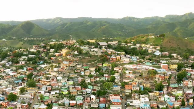 Aerial View of Exotic Tropical Mountain Town Series 4K Aerial Shot of mountains and beautiful villa in tropical paradise puerto rico stock videos & royalty-free footage