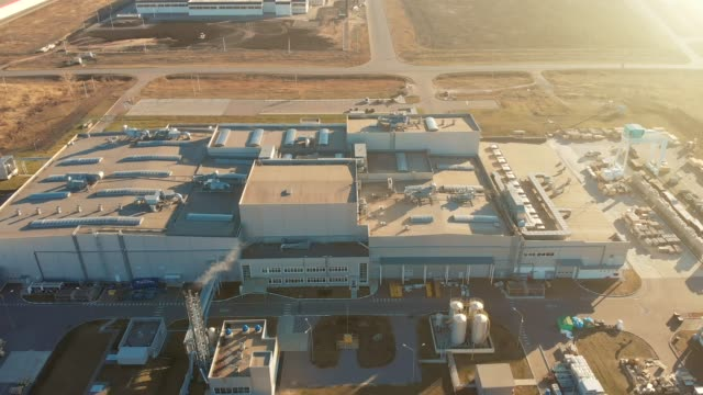 Aerial view of factory or warehouse building at sunset video