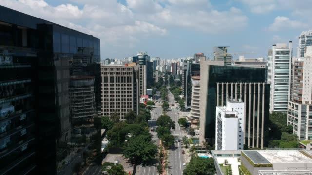 Aerial view of Faria Lima avenue, modern architecture in Sao Paulo Aerial view of Faria Lima avenue, modern architecture in Sao Paulo, Brazil marginal pinheiros stock videos & royalty-free footage