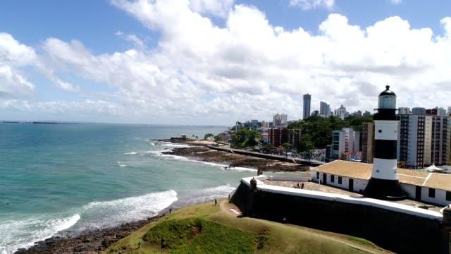vídeos de stock, filmes e b-roll de aerial view de farrol da barra em salvador, bahia, brasil - nordeste