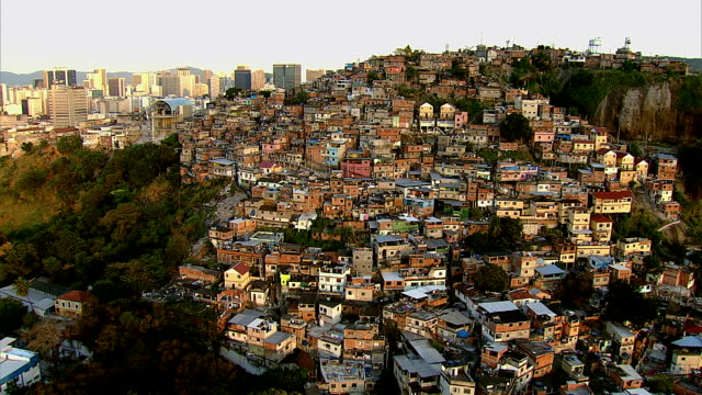 Aerial view of favela and city, Rio de Janeiro Aerial view of favela and city, Rio de Janeiro, Brazil brazil stock videos & royalty-free footage