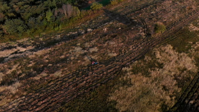 Aerial View of field and tractor mower at Sunrise in 4K