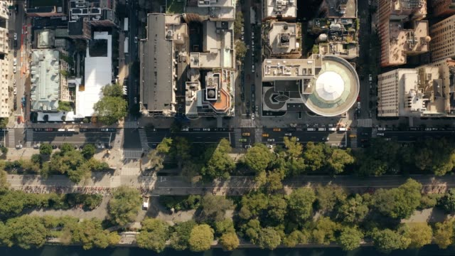 aerial view of fifth avenue traffic and central park 4k - american architecture stock videos & royalty-free footage