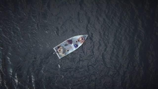 aerial view of fishermans fishing from a boat - łowić ryby filmów i materiałów b-roll