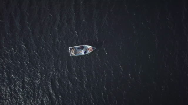 Aerial View of Fishermans Fishing From a Boat 4K UHD Video Aerial View of seniors Fishermans Fishing From a Boat recreational boat stock videos & royalty-free footage