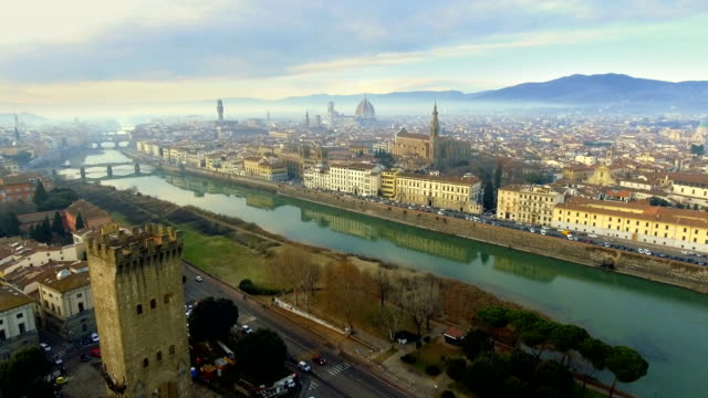 Aerial view of Florence, Italy at sunset. Cathedral Santa Maria, Old Bridge and mountains at the background Aerial view of Florence, Italy at sunset. Cathedral Santa Maria, Old Bridge and mountains at the background renaissance architecture stock videos & royalty-free footage