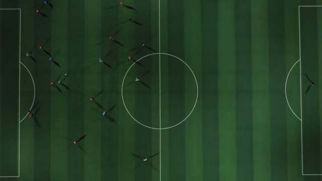 Aerial view of football team played at nighttime.soccer field in top view video