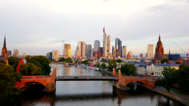 aerial view of  frankfurt city with river and skyscrapers during sunrise - francoforte sul meno video stock e b–roll