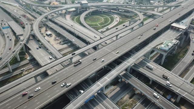 aerial view of freeway intersection road - estakada skrzyżowanie dróg filmów i materiałów b-roll