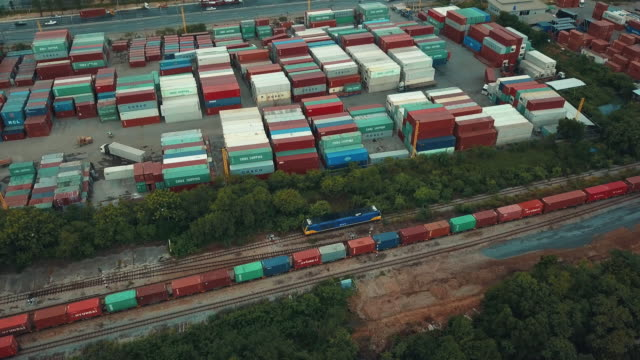 Aerial view of freight train with cargo containers video