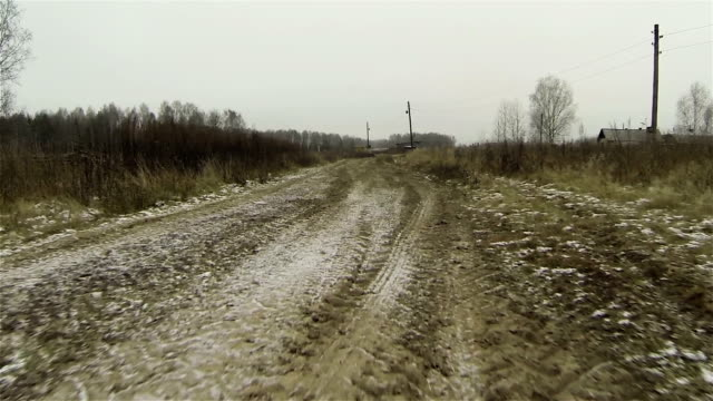 Aerial view of frozen dirty road in country side, first snow in russia video