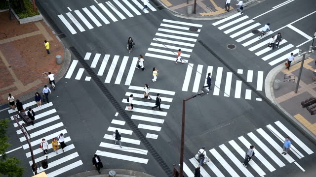 Aerial view of Fukuoka crosswalk traffic time lapse. Crowd of people and car crossing. Real time footage. video