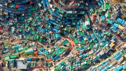 Aerial view of Gamcheon Culture Village in Busan, South Korea Gamcheon-dong, Saha District, Busan, South Korea. The area is known for its steep streets, twisting alleys, and brightly painted houses multi colored stock videos & royalty-free footage