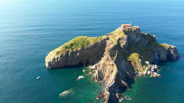 Aerial view of Gaztelugatxe - an islet in Basque Country, Spain, during a bright sunny day. 4K, UHD