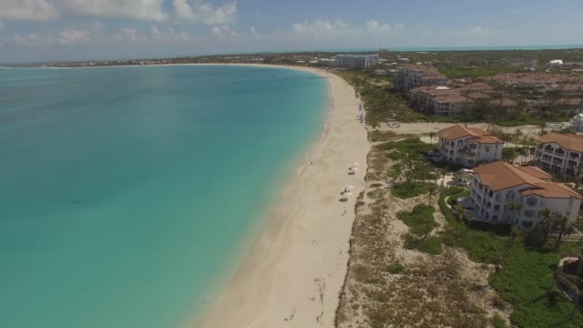 Aerial View of Grace Bay, Providenciales, Turks and Caicos Aerial View of Grace Bay, Providenciales, Turks and Caicos grace bay stock videos & royalty-free footage