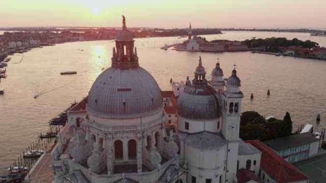 Aerial View of Grand Canal at sunrise Aerial view of Santa Maria della Salute and San Marco square at sunrise church architecture stock videos & royalty-free footage