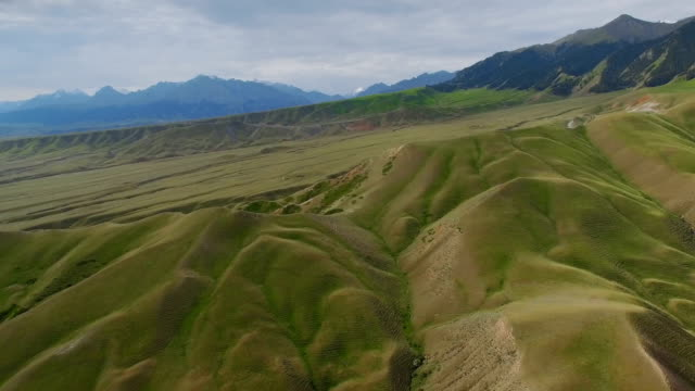 Aerial view of grassland in Tianshan Mountain,Xinjiang,China. Aerial view of grassland in Tianshan Mountain,Xinjiang,China. country geographic area stock videos & royalty-free footage