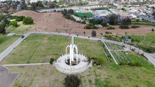 Aerial view of Greenwood Memorial Park & Mortuary. Memorial statue with American flag